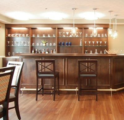A beautiful, wood-paneled pub, on-site at Canton Regency. Wrap around bar and high-back stools provide plenty of seating for friends enjoying a happy hour.
