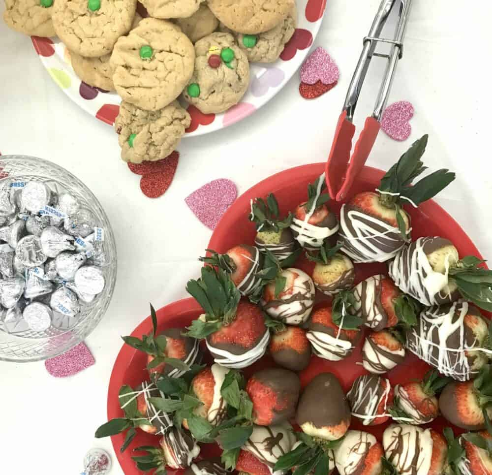Valentine's Day food including M&M cookies, chocolate kisses and chocolate covered strawberries