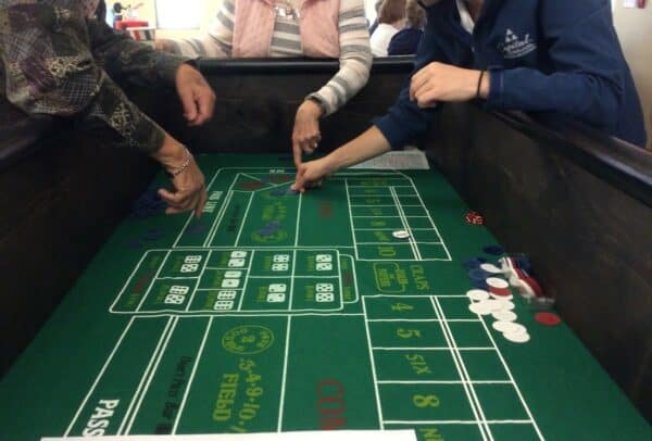 Group of seniors playing a game of Craps at senior living community in Green Bay, Wisconsin.