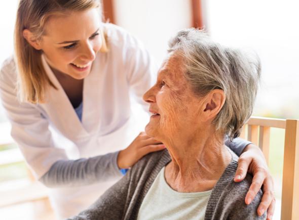 Nurse smiling with a senior woman