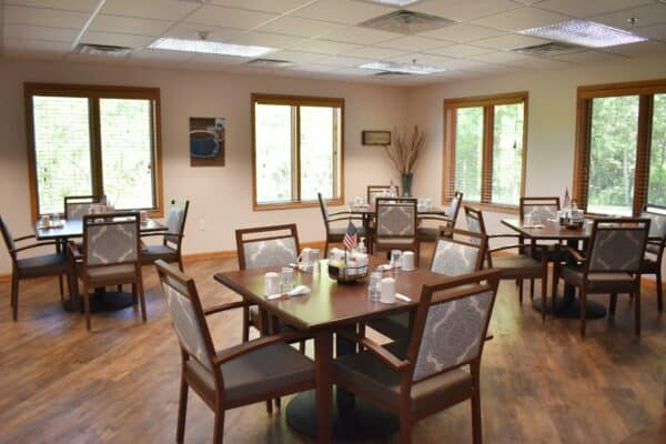 Dining room with ample seating at a senior living community in Green Bay, Wisconsin.