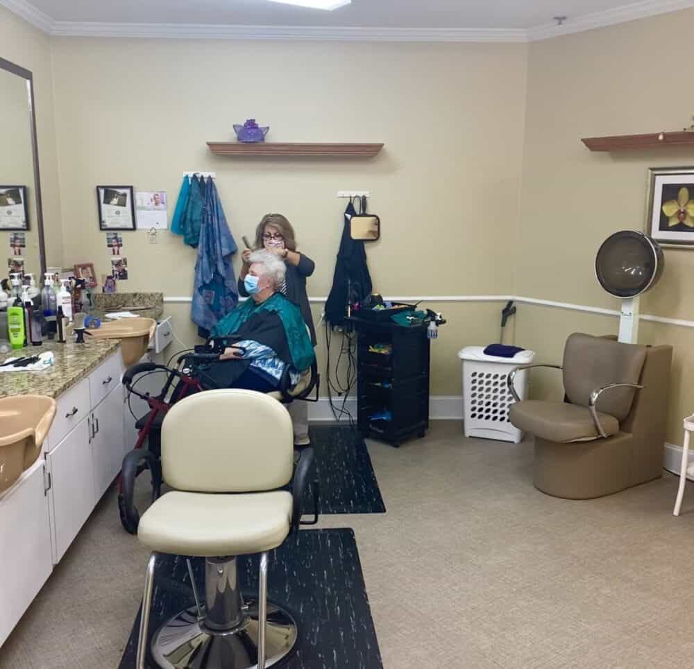 Senior woman gets her hair done a senior living community in Mesquite, Texas.