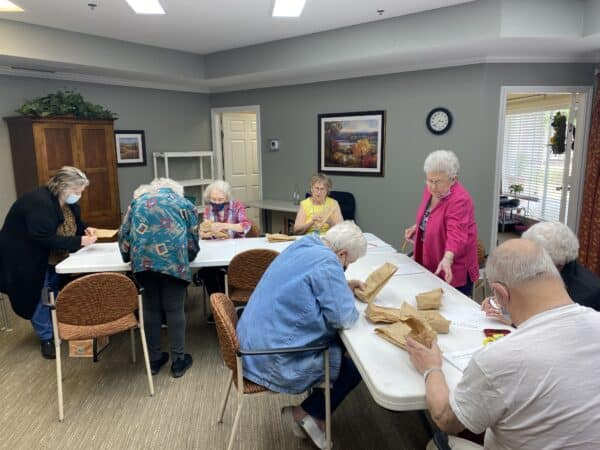 Group of seniors doing a craft together at a senior living community in Mesquite, Texas.