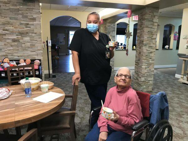 Senior woman and caregiver smile together at a senior living community in Omaha, Nebraska.