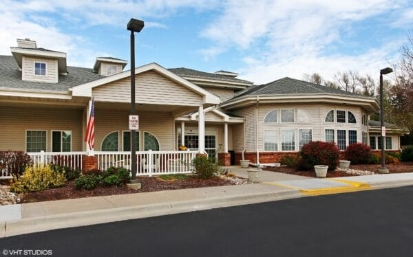 Front entrance with sitting area to senior living community in Lincoln, Nebraska.