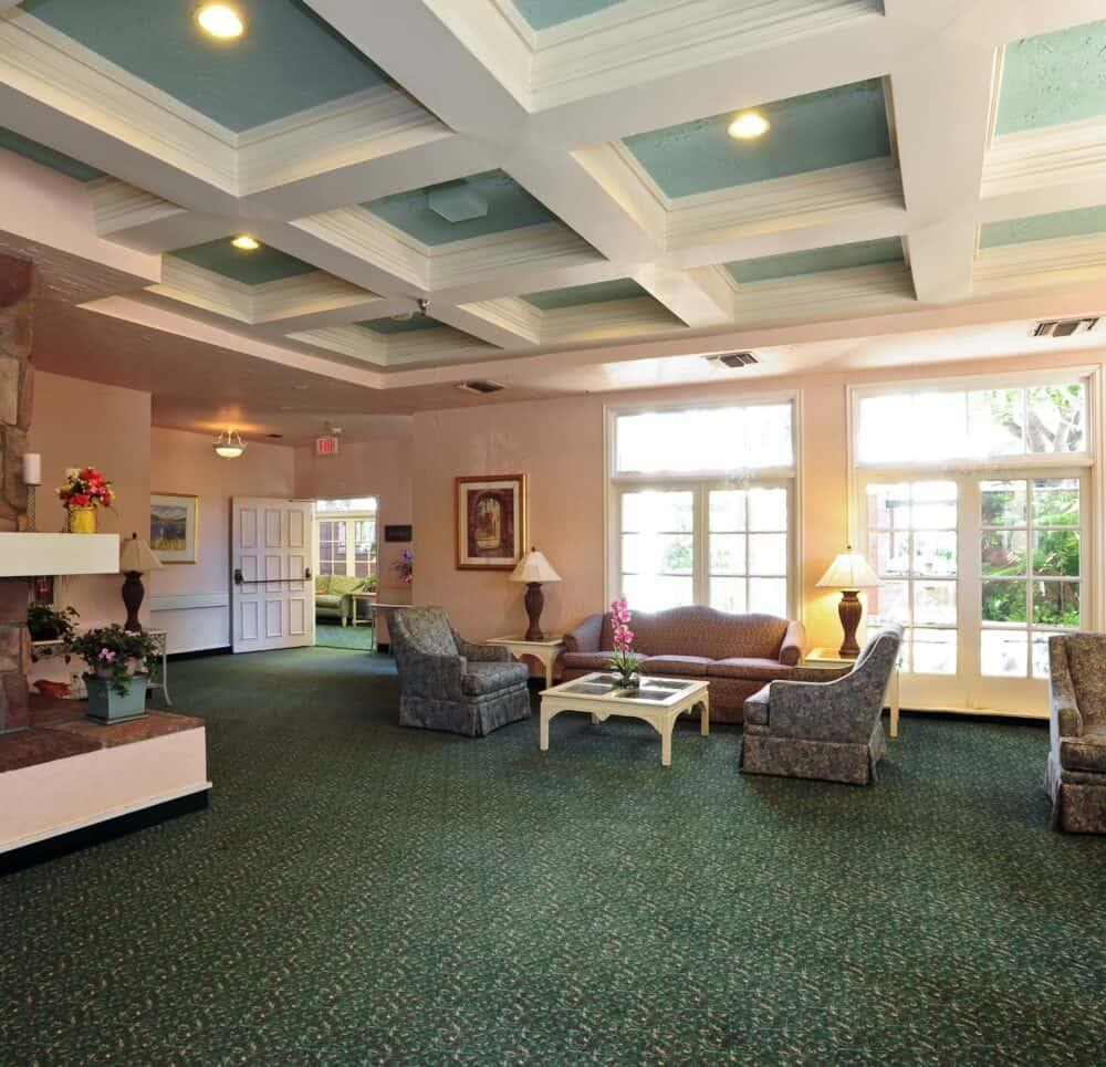 Lobby area with a fireplace at the Villa Santa Barbara, a senior living community in Santa Barbara, California.
