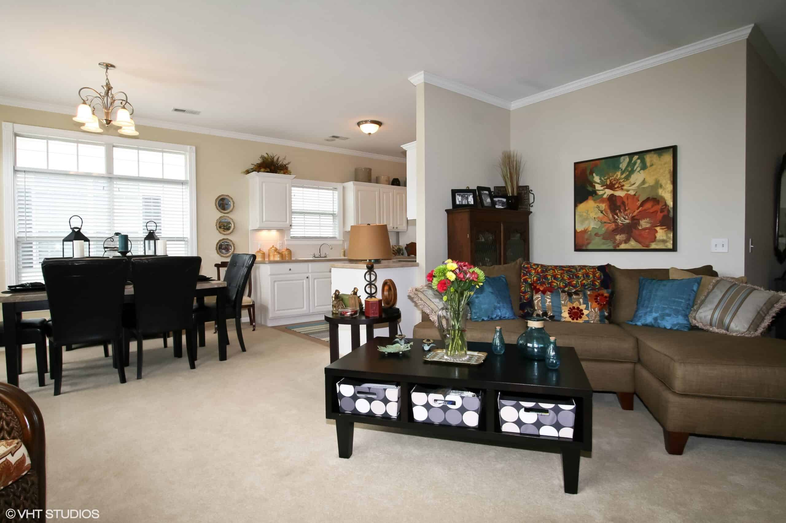 living room and kitchen in a senior apartment at the vintage gardens senior living community