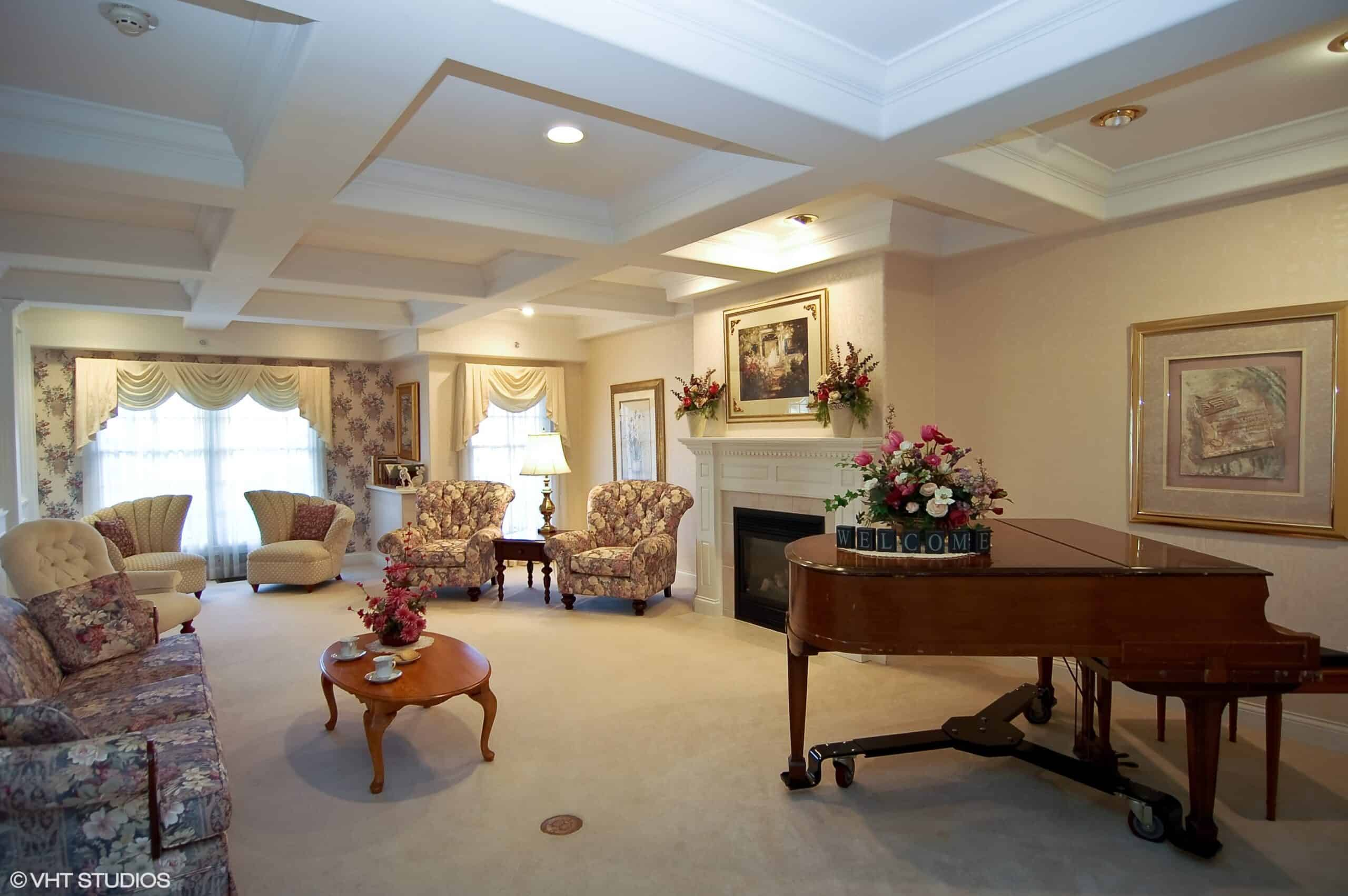 wynnfield crossing, a senior living community in rochester, indiana, has a lounge area with a piano