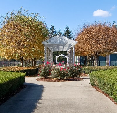 A beautiful gazebo amidst landscaping and walking paths.