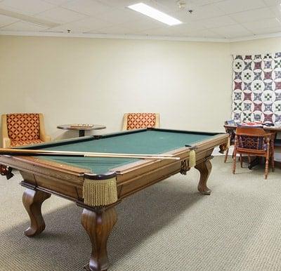 A billiards table in a spacious activity center in Mesquite, Texas.