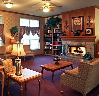 A cozy fireplace with comfortable lounge seating in Jeffersonville, Indiana.