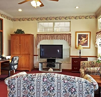 A big-screen TV in a comfortable lounge area in Jeffersonville, Indiana.