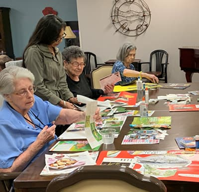 Residents enjoying a craft activity in Humble, Texas.