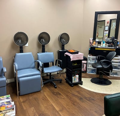 Rosemont\'s on-site beauty salon with multiple drying stations and a styling chair in Humble, Texas.