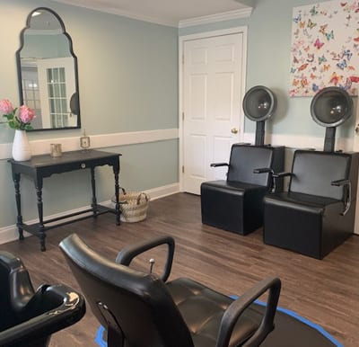 Clean and modern salon with multiple chairs and stations.