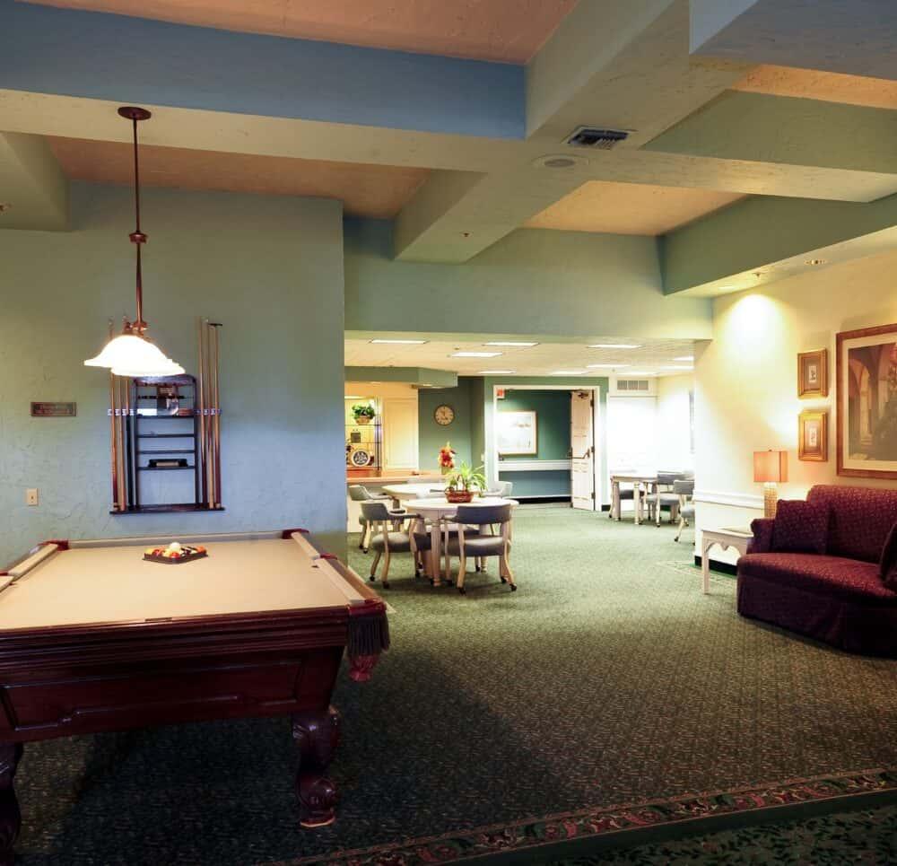 Billiards table and lounge space at the Villa Santa Barbara, a senior living community in Santa Barbara, California
