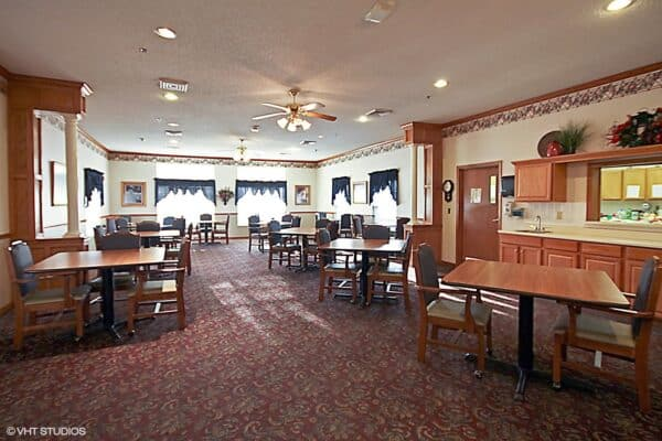 Riverbend senior living dining room with comfortable seating in Jeffersonville, Indiana.