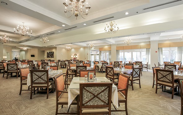 Large and elegant dining room with many tables and chairs and chandeliers in Ridgeland, Mississippi.