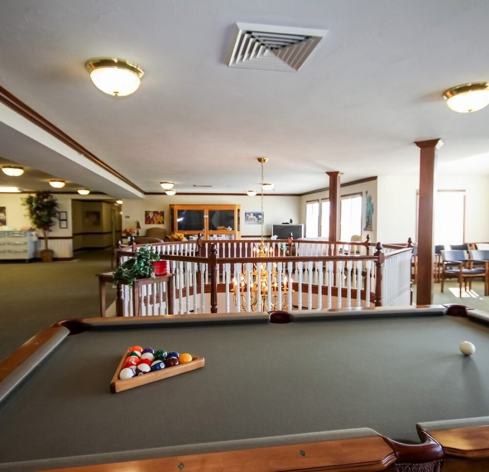 Billiards table overlooking the lounge area at a senior living community in Batesville, Indiana.