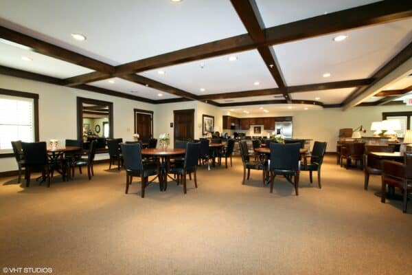 Dining room with mahogany beams and ample seating at senior living community in St. Joseph, Missouri.