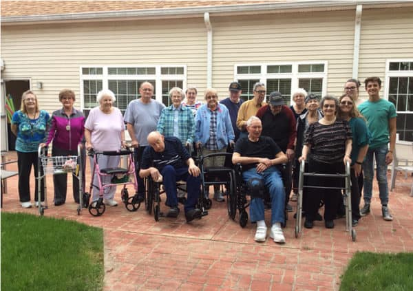 A group of residents and staff gathered outside at Keystone Woods in Anderson, Indiana.