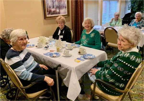 A group of elderly women at a holiday party at their senior living community in Perrysburg, Ohio.