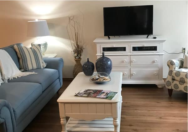 A model apartment living room with stylish furniture and a big-screen TV in Raleigh, North Carolina.