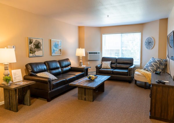 The living room of an independent living apartment with couches in Maple Grove, Minnesota.