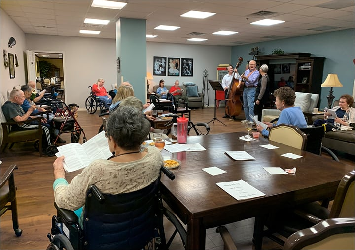 A sing-along at a retirement home with residents sitting in chairs in Humble, Texas.