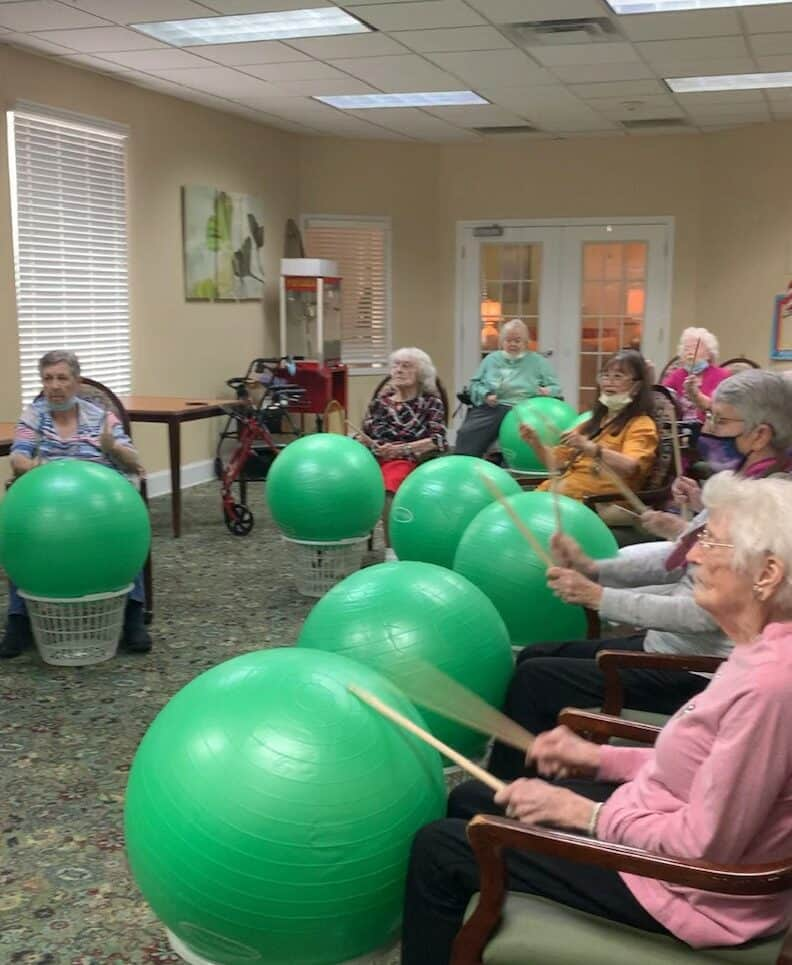Group of seniors exercise during an activity at a senior living community in Plano, Texas.