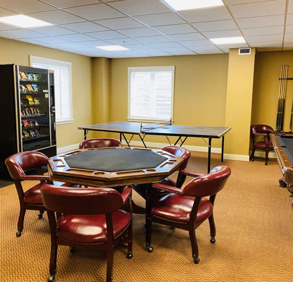 Activity room with table and pool table and ping pong at senior living community in Cincinnati, Ohio.
