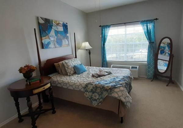 Model bedroom in a senior apartment at a senior living community in San Antonio, Texas.