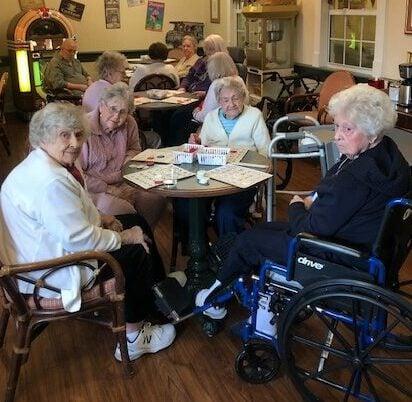 Senior ladies playing bingo in the ice cream parlor at a senior living community in Hamilton, Ohio.