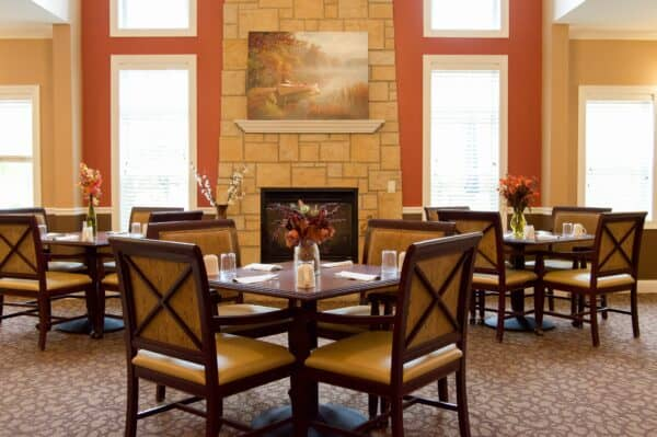 Dining room at the Waterford at Fitchburg, a senior community in Fitchburg, Wisconsin with lots of natural light and many tables..