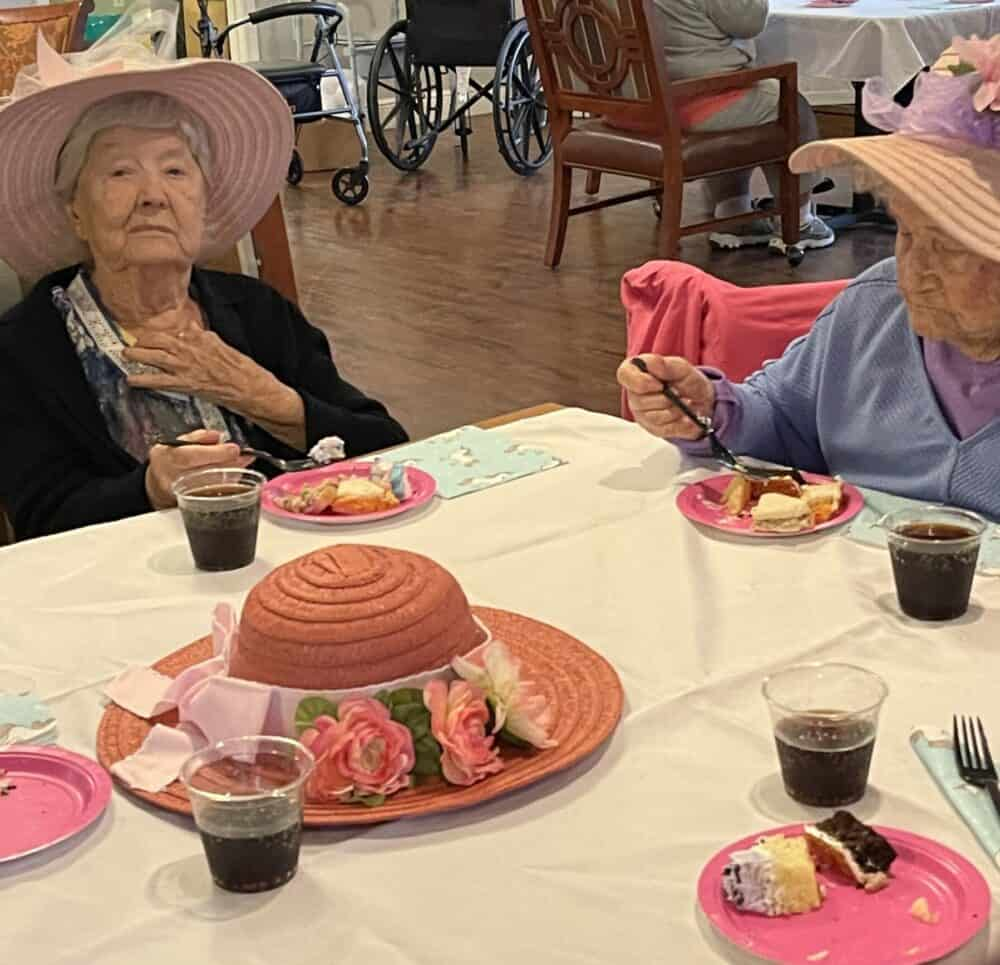 Senior women eat together at a memory care community in Pensacola, Florida.