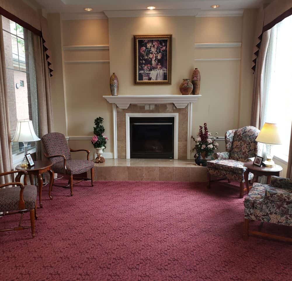 fireplace seating area at the waterford at fairfield, a senior living community located in ohio