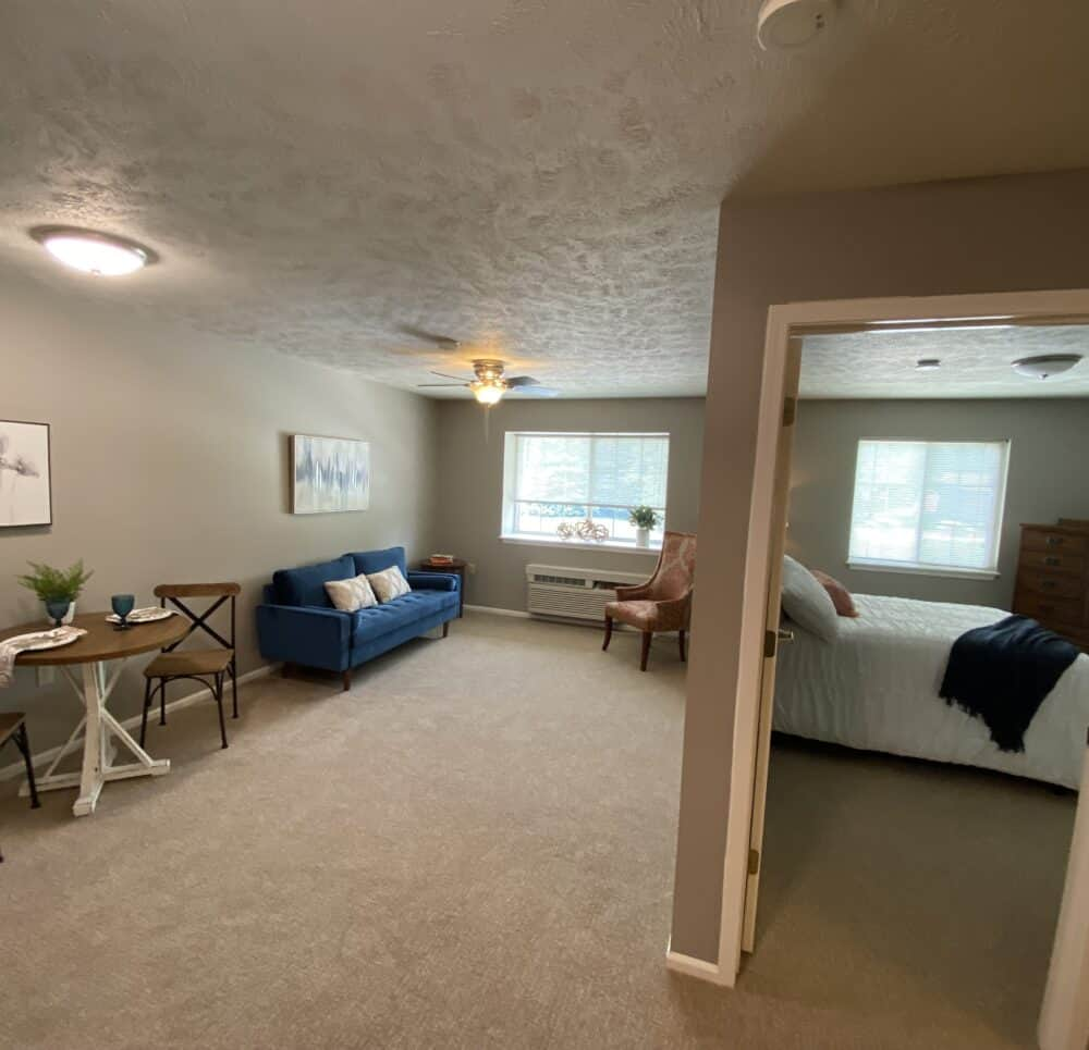 bedroom and living area at the waterford at miracle hills
