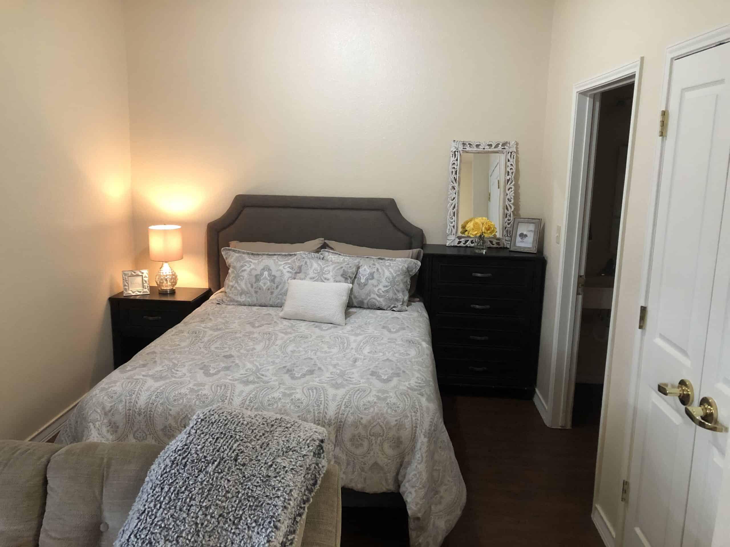 Model apartment bedroom at Good Tree senior living in Stephenville, Texas