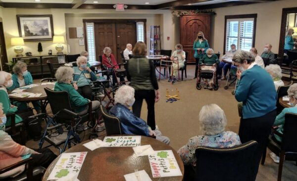 Group of seniors playing a game at the Vintage Gardens, a senior living community in St. Joseph, Missouri.