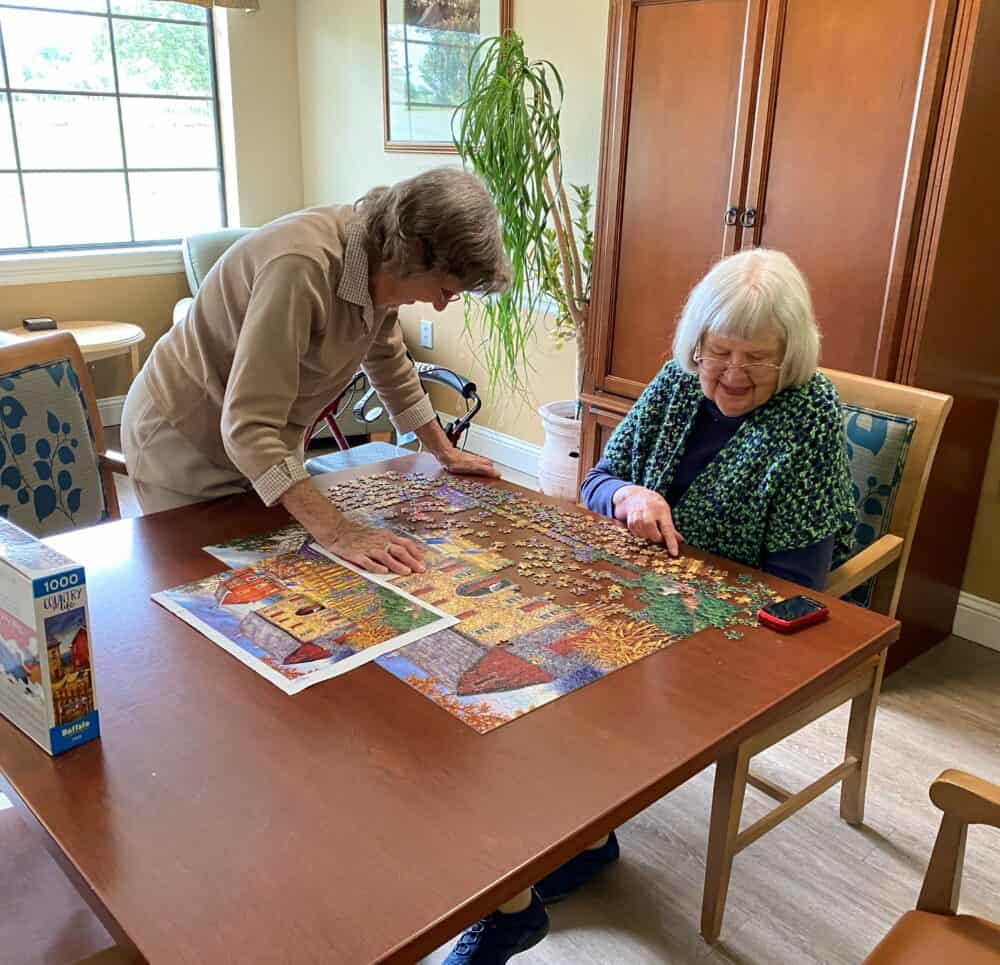 two senior women solving a puzzle