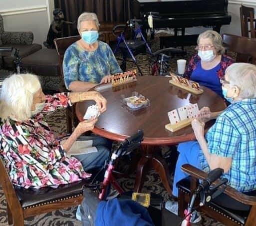 Four senior women play Rummy at a senior living community in Stephenville, Texas.