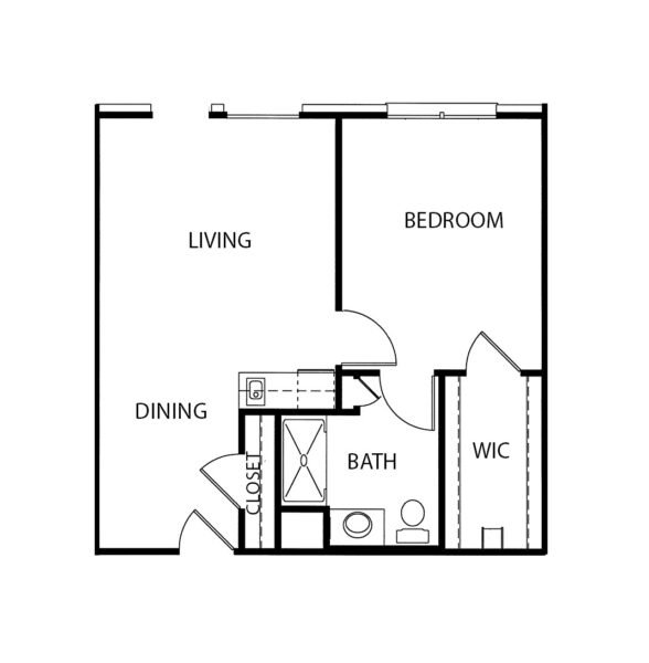 One-bedroom apartment with living room, bathroom and kitchenette at a senior living community in Fort Worth, Texas.