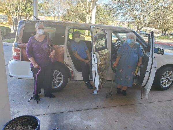 Group of seniors using the community bus at a senior living community in San Antonio, Texas.