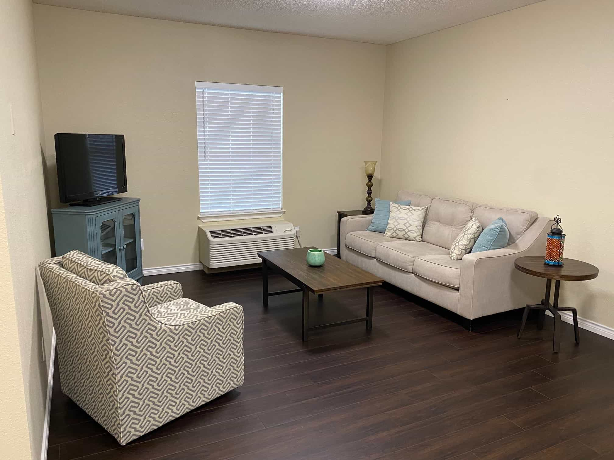 living room in a senior apartment at the waterford at ironbridge, a senior living community located in Springfield, Missouri