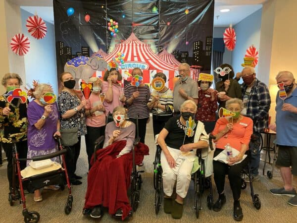 Seniors smile while at a party at a senior living community in Richardson, Texas.