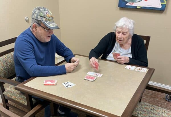 Two seniors playing a game of cards at the Waterford at Mansfield, a senior living community in Mansfield, Ohio.