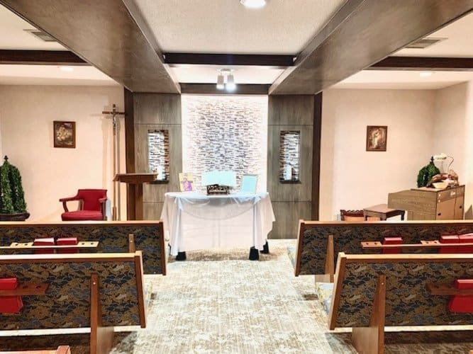 On-site chapel complete with aisles, kneelers and a podium area