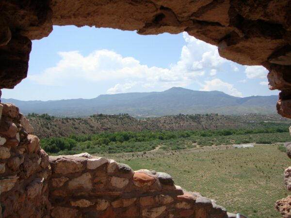 A landscape view through the cut-out window in the wall; ancient Tuzigoot National Monument ruins near Clarkdale, Arizona.
