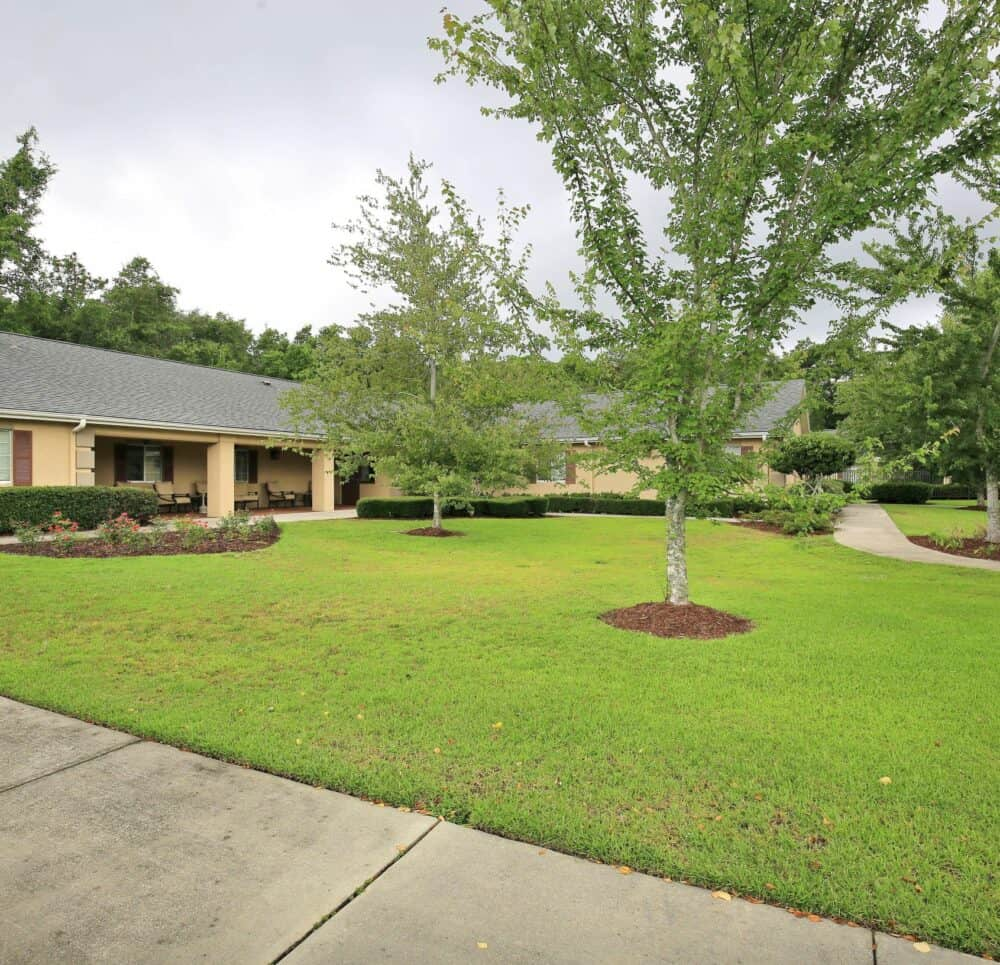 Outdoor courtyard area at a memory care community in Pensacola, Florida with walking paths.