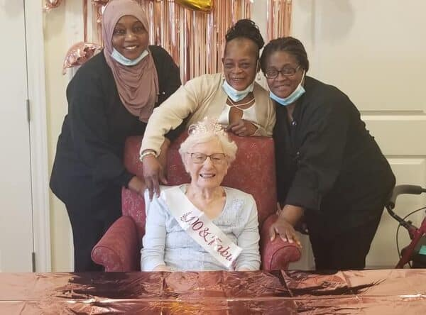 Group of women smile during a birthday celebration at a senior living facility in Dayton, Ohio.